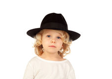 Lustiges kleines blondes Kind mit schwarzem Hut Lizenzfreies Stockfoto