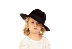 Lustiges kleines blondes Kind mit schwarzem Hut Lizenzfreies Stockbild