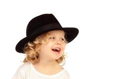 Lustiges kleines blondes Kind mit schwarzem Hut Stockfotos