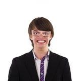 Lustiges Lächeln des jungen Mannes Stockfotos