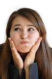 Lustiges Mädchen gewann die Luft im Mund Lizenzfreies Stockfoto