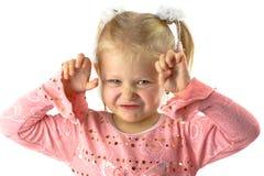 Lustiges Mädchen mit furchtsamem Gesicht lizenzfreies stockbild