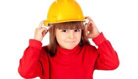 Lustiges Mädchen mit gelbem Sturzhelm Lizenzfreies Stockfoto