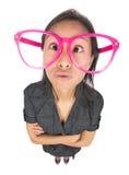 Lustiges Mädchen mit großen Gläsern Stockbilder