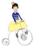 Lustiges Mädchenradfahren Stockfotos