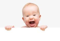 Lustiges nettes Baby mit der weißen leeren Fahne lokalisiert lizenzfreie stockfotos