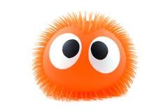 Lustiges orange Gesicht getrennt auf weißem Hintergrund Stockfotografie