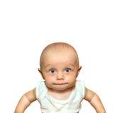 Lustiges Porträt eines entzückenden Babysaugens Stockfotos