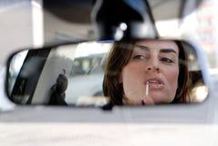 Lustre del labio en coche Imagen de archivo libre de regalías