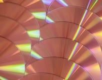Lustro compatto variopinto dell'arcobaleno del fondo di rosa giallo del disco di DVD del CD fotografie stock