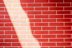 Lustro della luce di Sun al muro di mattoni rosso, fondo di struttura Fotografia Stock