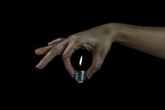 lustro leggero quando donna che tiene lampadina senza vetro Fotografia Stock Libera da Diritti
