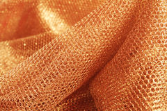 Lustrous elegant golden fabric Stock Images