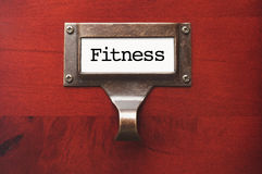 Lustrous Wooden Cabinet with Fitness File Label Stock Photography