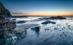 Lusty Glaze Beach at Newquay in Cornwall. Nightfall on Lusty Glaze beach at Newquay in Cornwall royalty free stock images