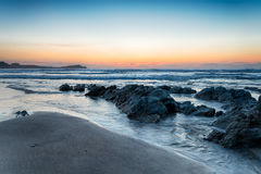 Lusty Glaze Beach. Sunset on Lusty Glaze beach at Newquay in Cornwall royalty free stock image