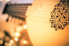 Luta med instrument- notblad och mjuka ljus för jul ferie, splittringsignal royaltyfri foto