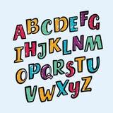 Lutade ned färgrika barn för vektor alfabetbokstäver, nummer och interpunktionssymboler Den roliga stilsorten innehåller grafisk  Arkivfoton
