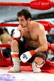 Lutador misturado das artes marciais no canto do anel Imagem de Stock Royalty Free