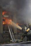Lutadores de incêndio Imagens de Stock