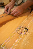 A lute-maker at work Stock Images