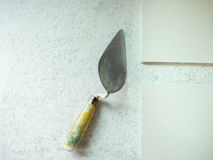 Lute trowel and tile ceramic Construction tool on cement backgr royalty free stock image