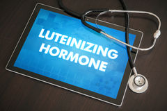 Luteinizing hormone (menstrual cycle related) diagnosis medical. Concept on tablet screen with stethoscope royalty free stock image