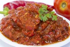 Lutenica peppar och tomat Arkivfoto