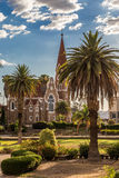 Luteran Christ Church and park with palms in front, Windhoek, Na Stock Images