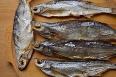 Lutfisk Sabrefish på tabellen royaltyfria foton
