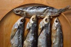 Lutfisk Sabrefish på tabellen royaltyfri foto