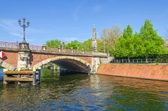 Luther Bridge German: Lutherbruecke with cast-iron candelabra. Berlin, Germany - April 22, 2018: Banks of the river Spree and the Luther Bridge German Royalty Free Stock Image