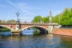 Luther Bridge German: Lutherbruecke with cast-iron candelabra. Berlin, Germany - April 22, 2018: Banks of the river Spree and the Luther Bridge German Stock Photography