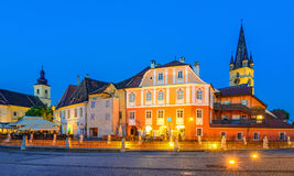 Lutheran Cathedral,  with Huet Square, medieval Saxon city of Si. Lutheran Cathedral, seen from the Small Square with Huet Square, medieval Saxon city of Sibiu Stock Image