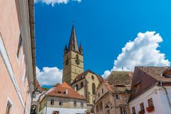 Lutheran Cathedral of Saint Mary on a beautiful sunny summer day in Sibiu, Transylvania region, Romania.  stock photos