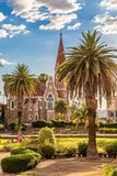 Lutheran Christ Church and park with palms in the front, Windhoek royalty free stock photos