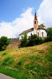 Lutheran Church. The Lutheran Church At the Foot Of The Italian Alps Royalty Free Stock Photography