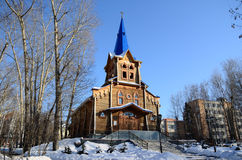 Lutheran Church. Wooden Lutheran church in the park in Tomsk, Russia Royalty Free Stock Images