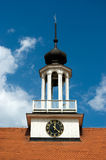 Lutheran church bell tower. Against blue cloudy sky Royalty Free Stock Images