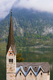 The Lutheran church and mountains overgrown with forests Royalty Free Stock Image