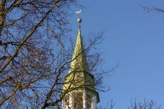 Lutheran church tower on blue sky background. Rauna Church in Latvia royalty free stock images