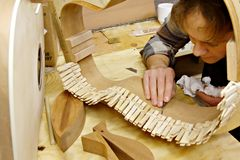 Luthier Building Guitar in Workshop Stock Image