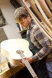 Luthier Inspecting Handmade Guitar in Workshop Stock Photos
