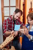 Luthier teaches apprentice Stock Images