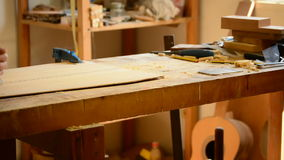 Luthier working in a flamenco guitar with a wood planer Royalty Free Stock Image