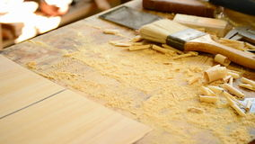 Luthier working in a flamenco guitar with a wood planer Royalty Free Stock Images