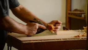 Luthier working in a flamenco guitar with a wood planer stock video