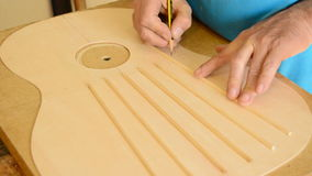 Luthier working on a guitar harmonica cover stock video