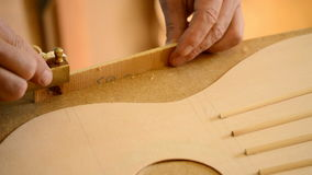Luthier working on a guitar harmonica cover stock video footage