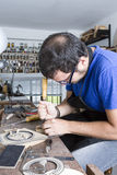 Luthier working a guitar rosette Stock Photos